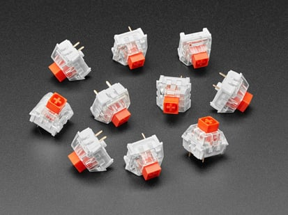 Angled shot of ten red Kailh key switches.