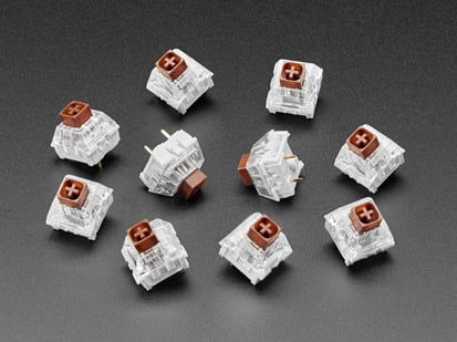 Angled shot of ten brown Kailh key switches.