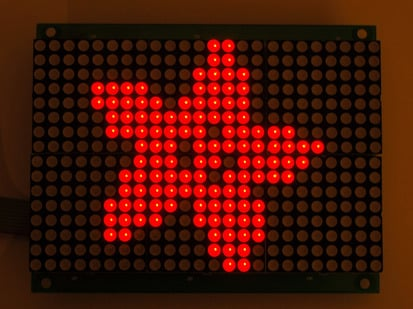 Red LED grid lit up with an adafruit logo