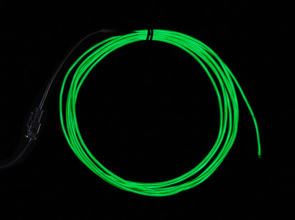 Coil of lit EL wire in green