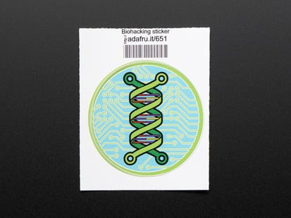 Circular sticker showing a green double helix over an abstracted blue and green circuitboard design. Badge is trimmed in green and mounted on white paper with barcode.