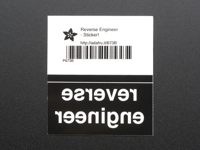 Black rectangular sticker with the backwards lettering REVERSE ENGINEER in white. Mounted on white paper with barcode