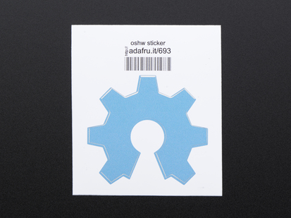 Light blue sticker in the shape of partial gear open source hardware logo. Mounted on white paper with barcode.