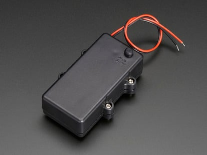 Angled shot of rectangular black waterproof 2 x AA battery holder with screws, plain wires, and on-off switch.