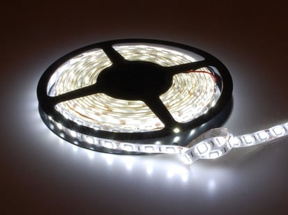 Spool of flexible LED strip lit up cool white