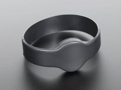 Rubber bracelet with round disc inside