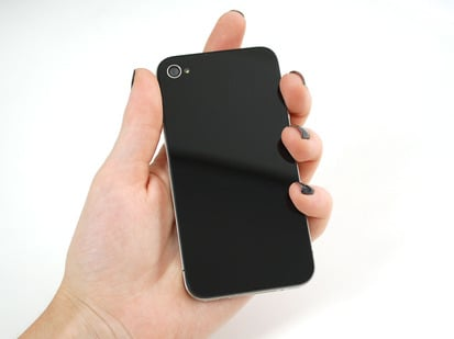Hand holding up iphone with flat black back