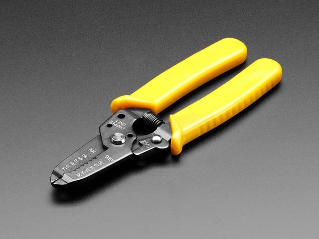 Multi-size wire stripper & cutter