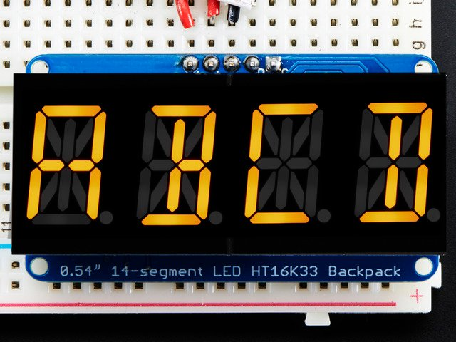 "Quad Alphanumeric Display - Yellow 0.54"" Digits w/ I2C Backpack"