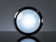 Head-on shot of illuminated massive white 100mm arcade button.