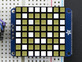 """Close-up of soldered and assembled Small 1.2"""" 8x8 Ultra Bright Square White LED Matrix + Backpack on a breadboard powered by an Arduino Uno. The LED Matrix displays a white smiley."""