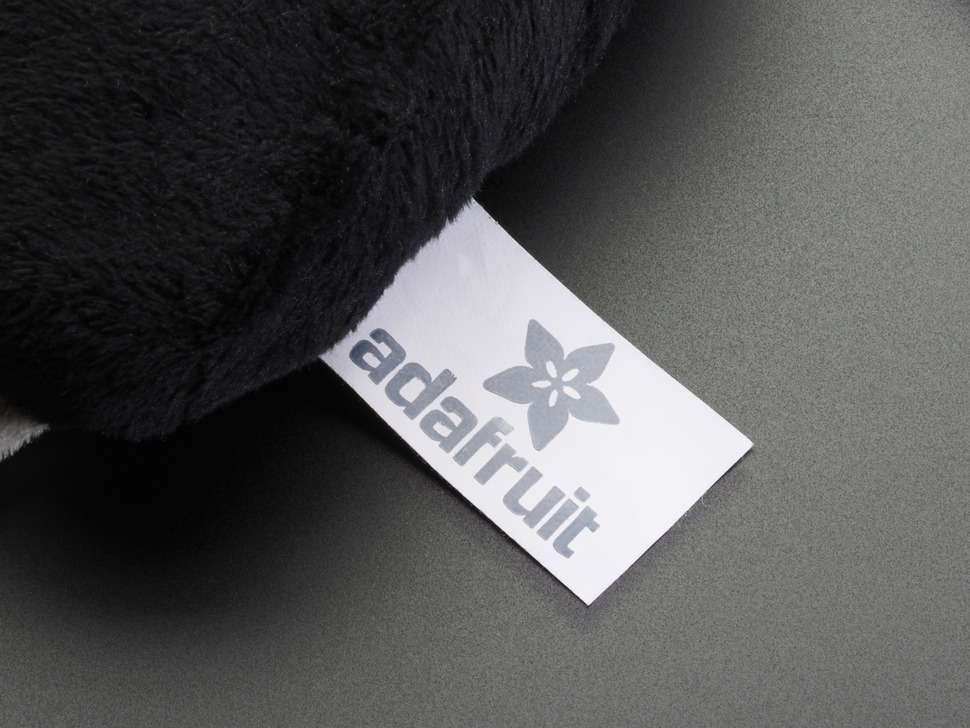Close-up of Adafruit tag on plushie.