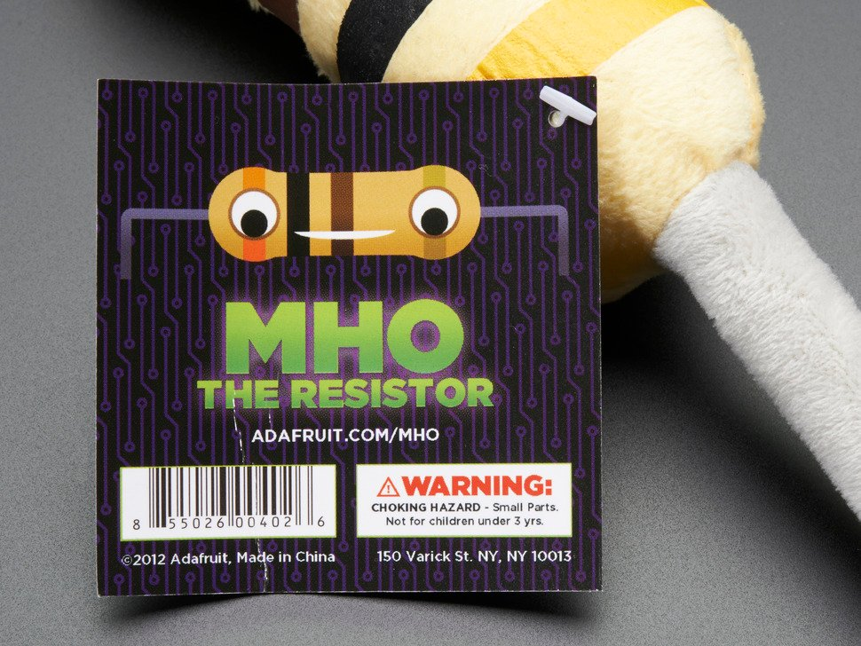 Close-up of Mho the resistor tag on plushie.