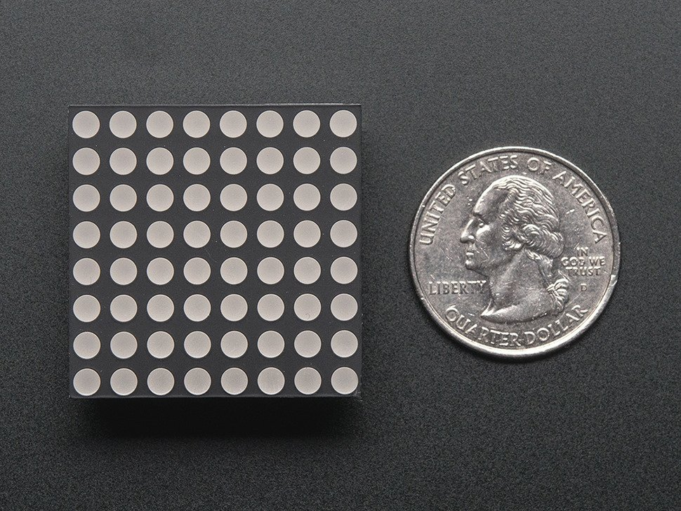"Small 1.2"" 8x8 Ultra Bright Blue LED Matrix. Powered Off, shown with quarter for scale."