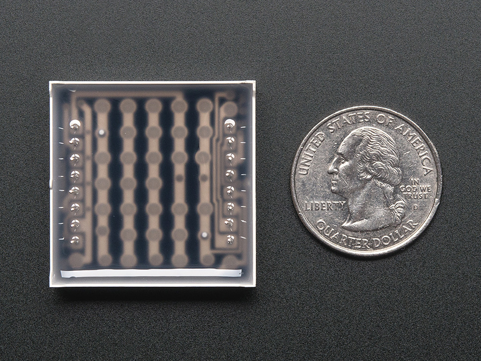 "Back shot of Small 1.2"" 8x8 Ultra Bright Blue LED Matrix. Powered Off, shown with quarter for scale."