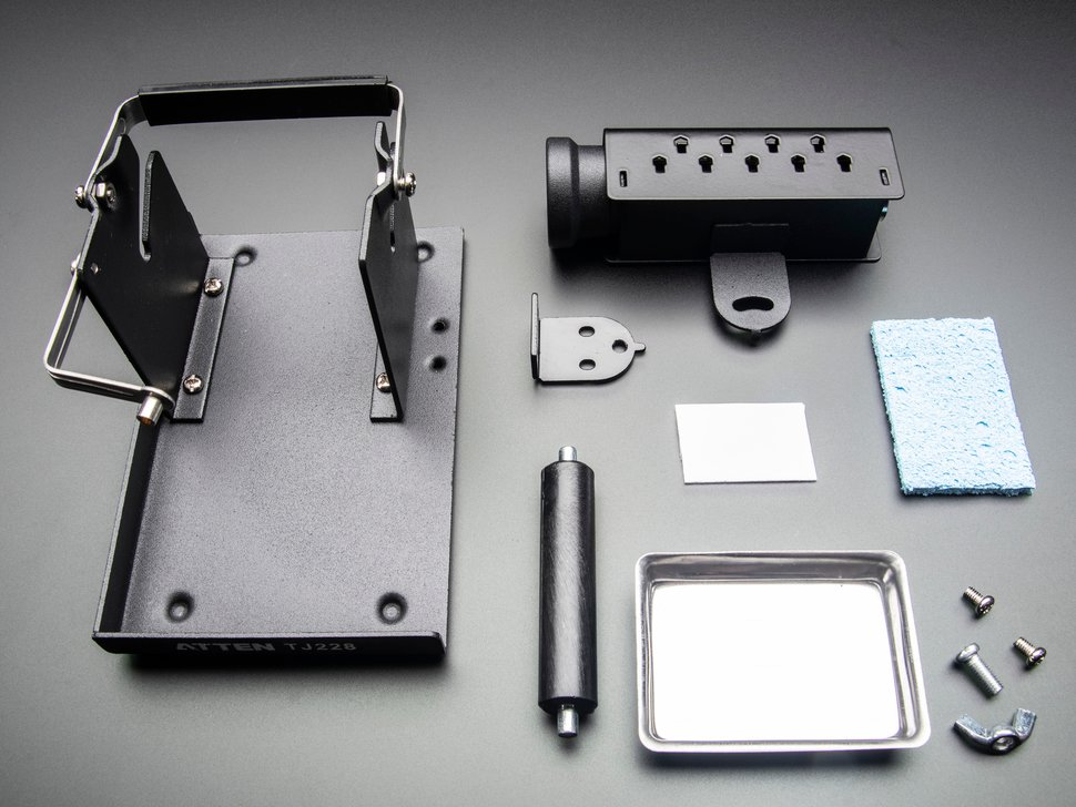 Disassembled kit showing various metal components