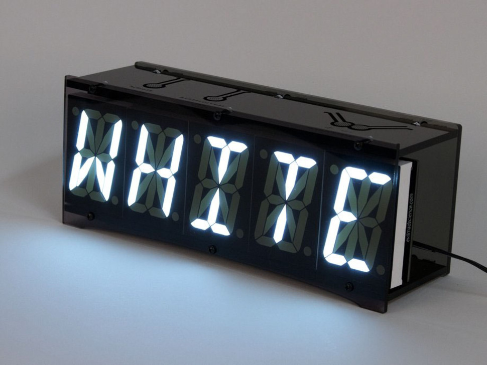 """Front of clock showing """"WHITE"""" text on display"""