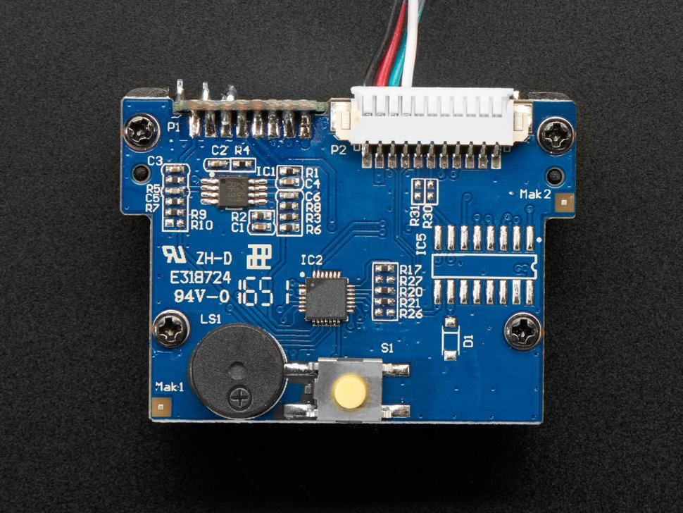 Top of module showing button and piezo