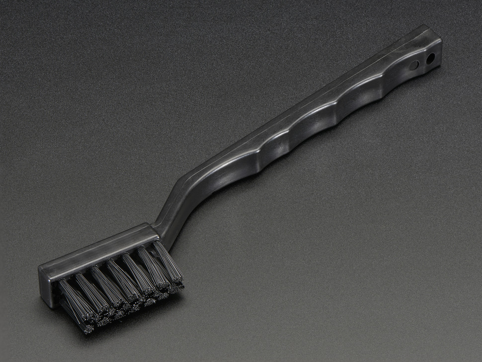 Black toothbrush-looking brush