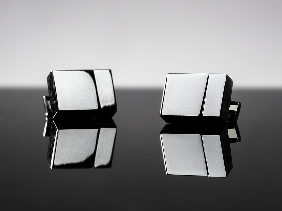 Two metal cufflinks shaped like USB drives