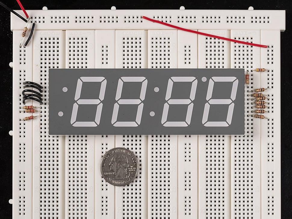Huge red 7-segment clock display with all segments unlit