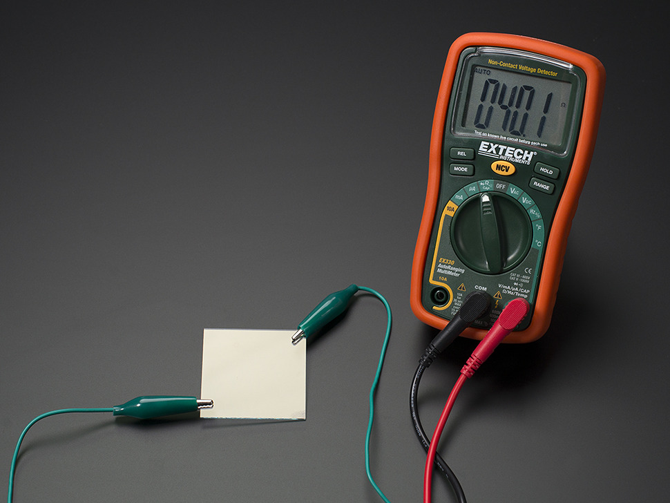 Multimeter measuring resistance of ITO sheet