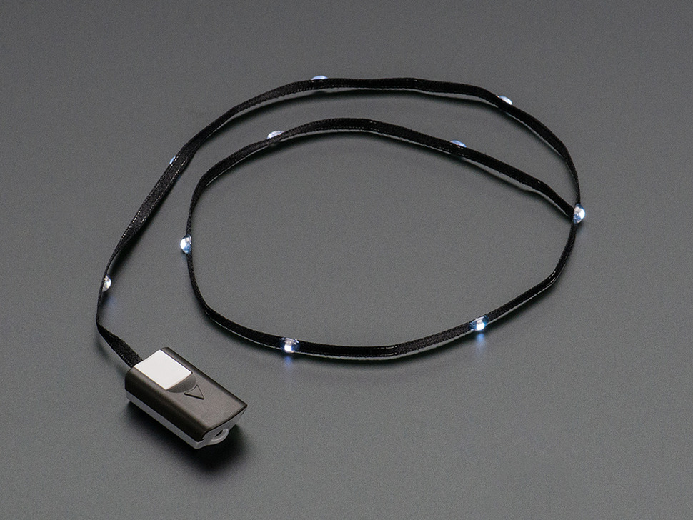 White LEDs on Black Fabric Ribbon with battery pack