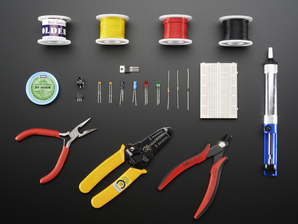 Collection of many electronic hand tools, components, and wire