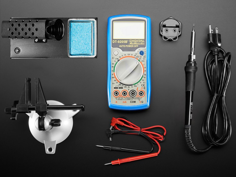 Top shot collection of many electronic hand tools and soldering equipment