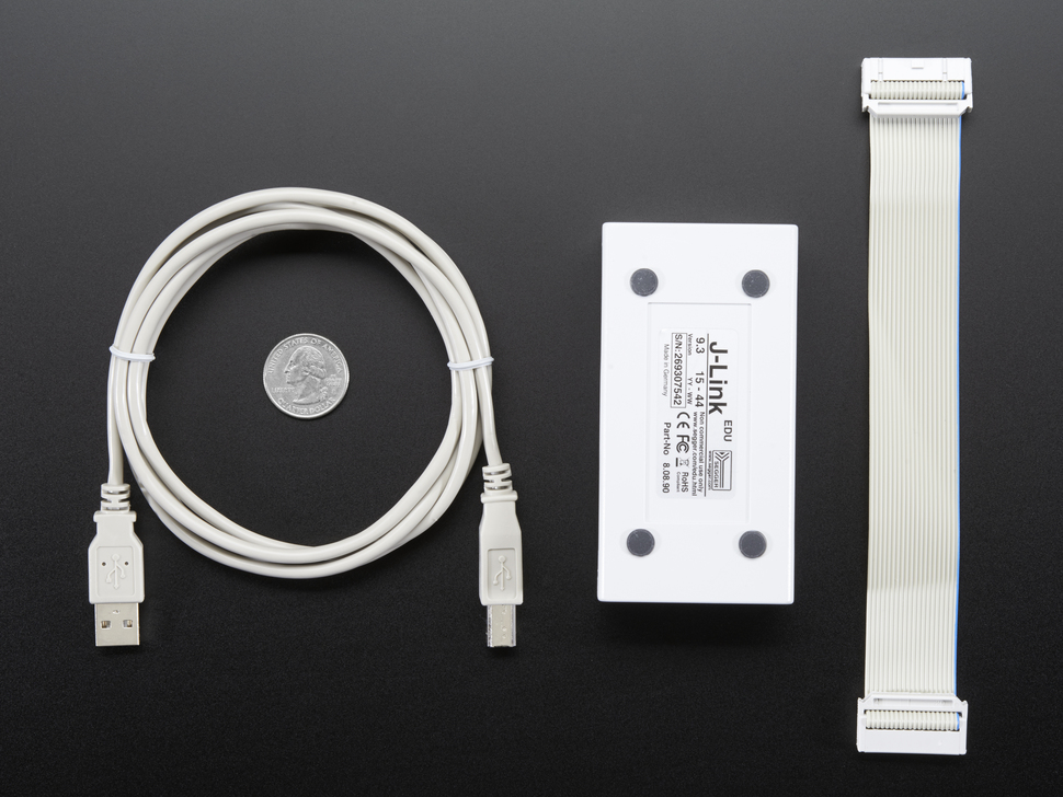 USB cable, JLink and JTAG cable next to quarter