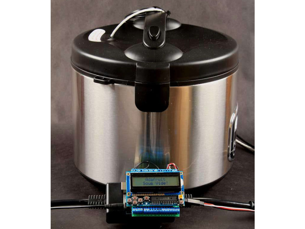 "Large cylindrical hot pot with Arduino in front with LCD screen displaying ""Sous Vide"""