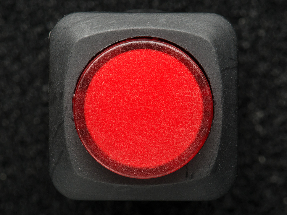 Top-down shot of red pushbutton.