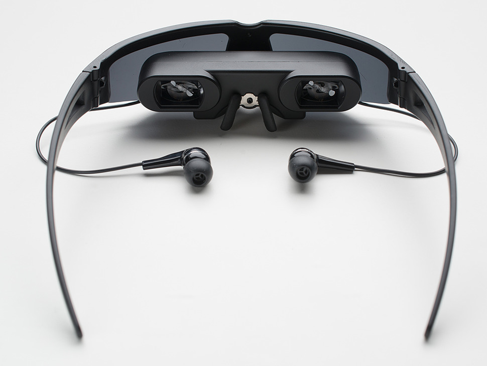 Back of cyber glasses with earbuds, showing two small displays