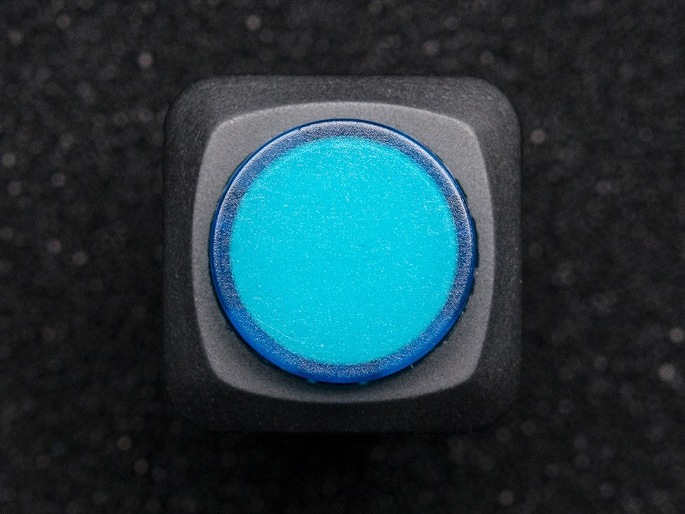 Top-down shot of blue round pushbutton.