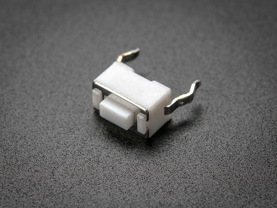 angled shot of single white 6mm tactile switch button.