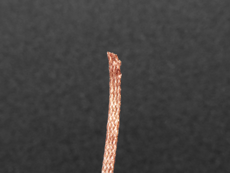 close up of wick showing woven copper