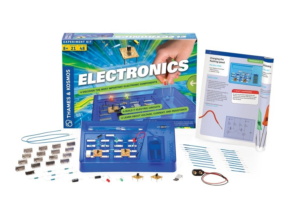 Thames & Kosmos Electronics Experiment Kit showing packaging, booklet and many electronic parts