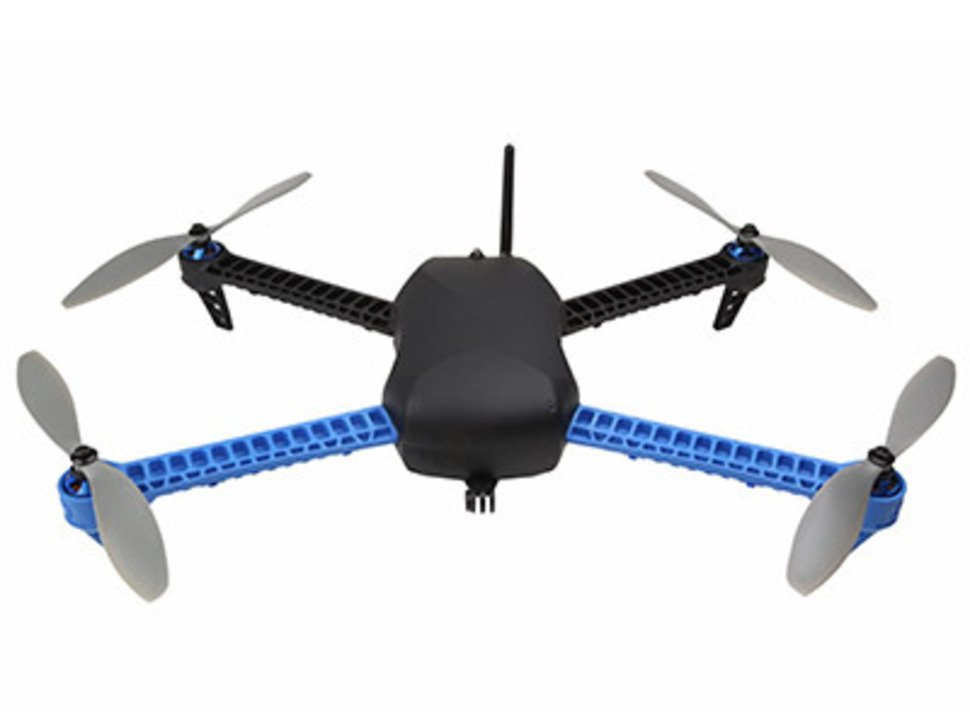 Top of IRIS Quad-copter with four propellers and antenna sticking out of center.