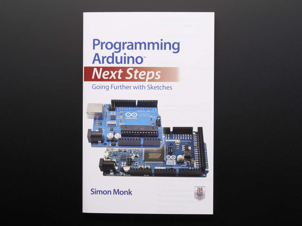 """Front cover of """"Programming Arduino: Next Steps - Going Further with Sketches"""" by Simon Monk. Cover features two blue rectangular microcontrollers, the Arduino Uno and Arduino Due."""