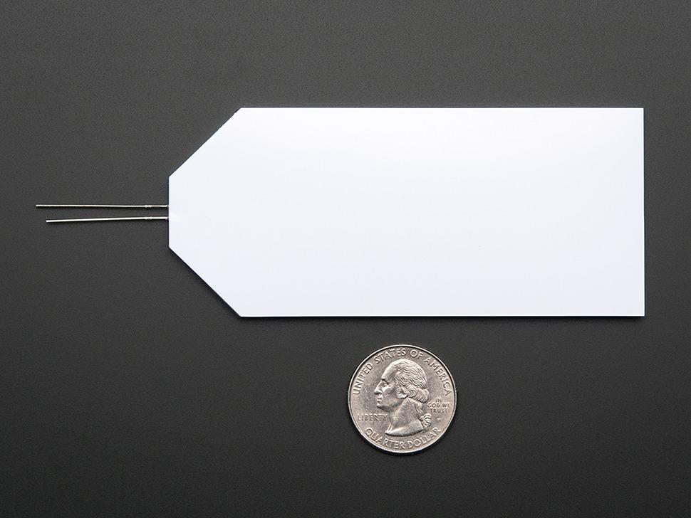 Unlit rectangular LED next to quarter