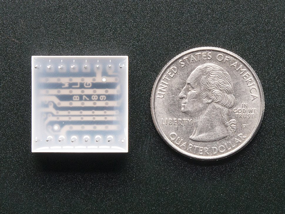 Miniature 8x8 Green Led Matrix. Back view, with quarter for scale.