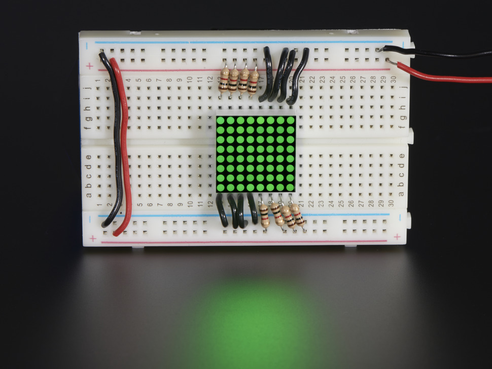 Miniature 8x8 Green Led Matrix. Shown attached to breadboard.