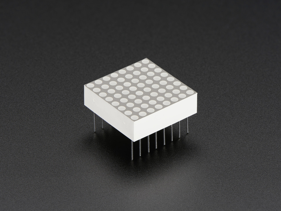 Miniature 8x8 Green Led Matrix. Angled view. Powered off with leads.
