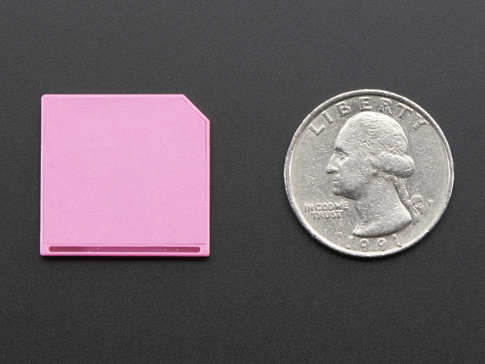 Pink Shortening microSD card adapter for Raspberry Pi & Macbooks