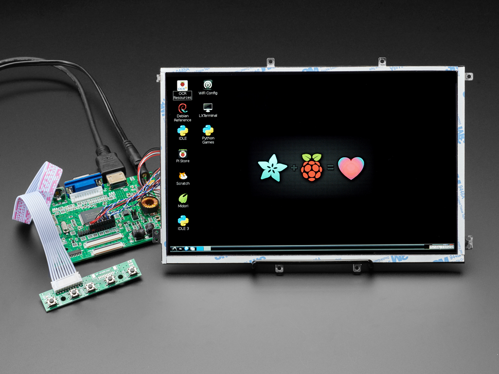 """Angled shot of assembled 10.1"""" Display & Audio 1280x800 IPS - HDMI/VGA/NTSC/PAL. The HDMI screen displays a desktop image including the Adafruit logo, the Raspberry Pi logo, and a pink heart."""