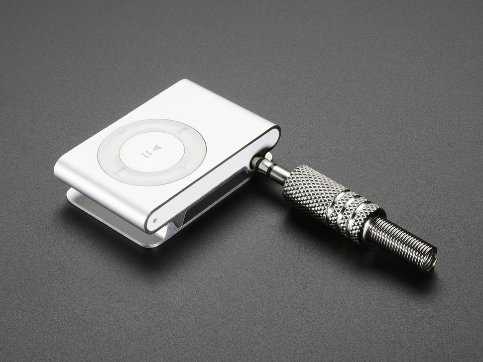 Stereo DIY plug partially inserted into iPod Shuffle
