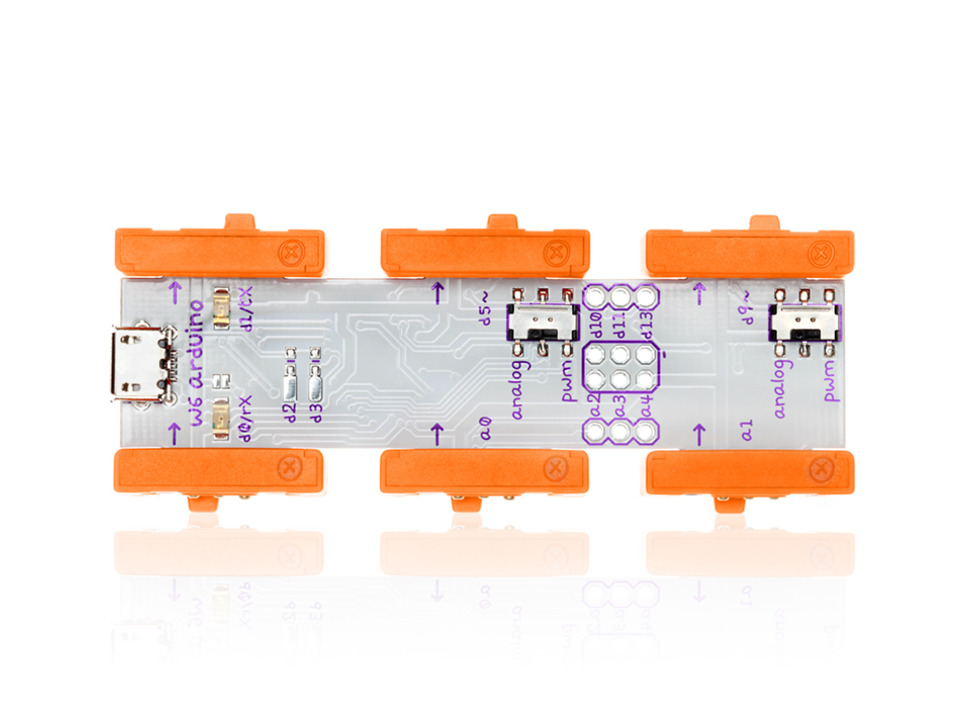 Close up of top of rectangular PCB with orange connectors