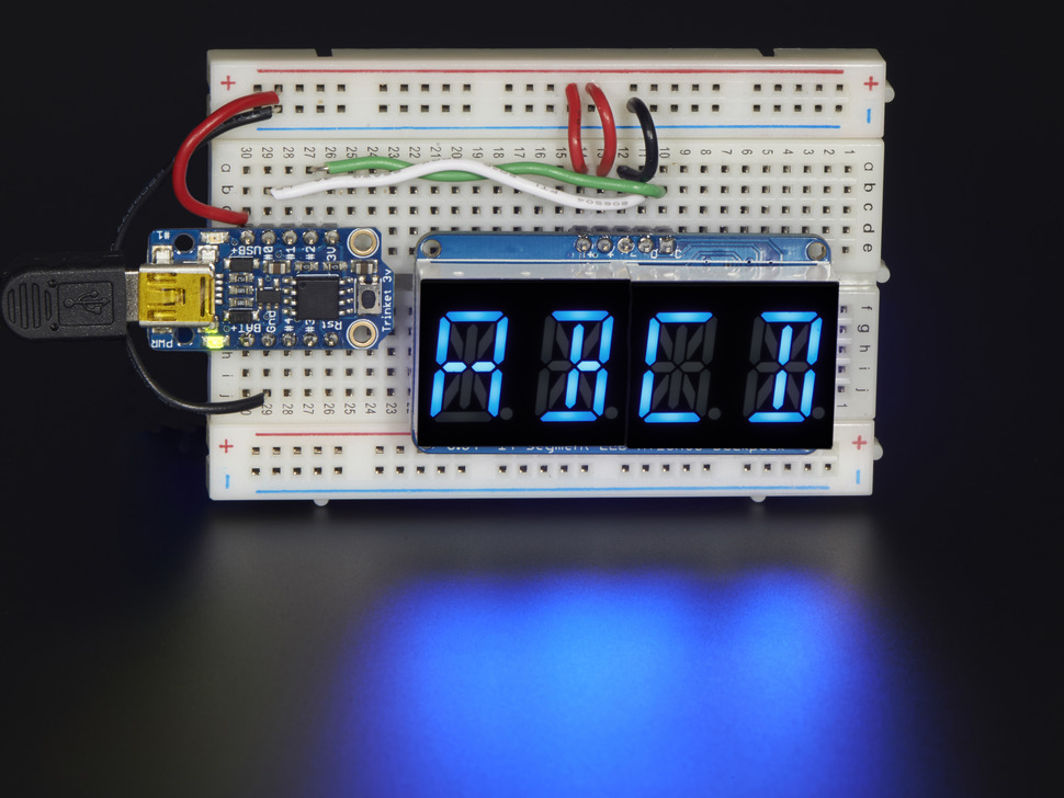 "Display wired to an Arduino on breadboard showing ""ABCD"""