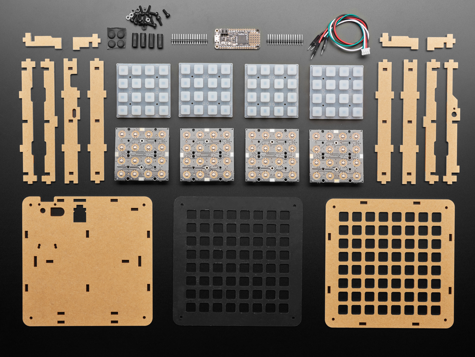 kit contents shot with many PCBs, plastic pieces and elastomers