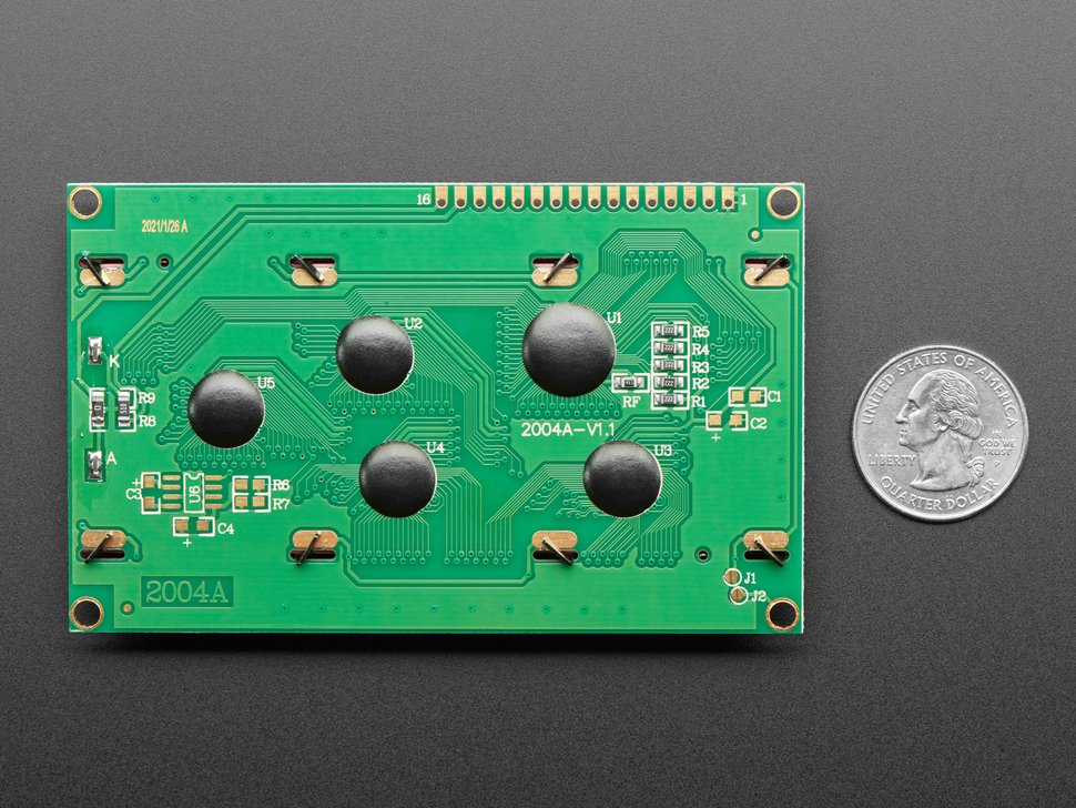 Back of LCD module next to quarter